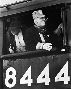 <p>Retired UP Railroad Chairman John C. Kenefick in the cab of No. 8444.</p>